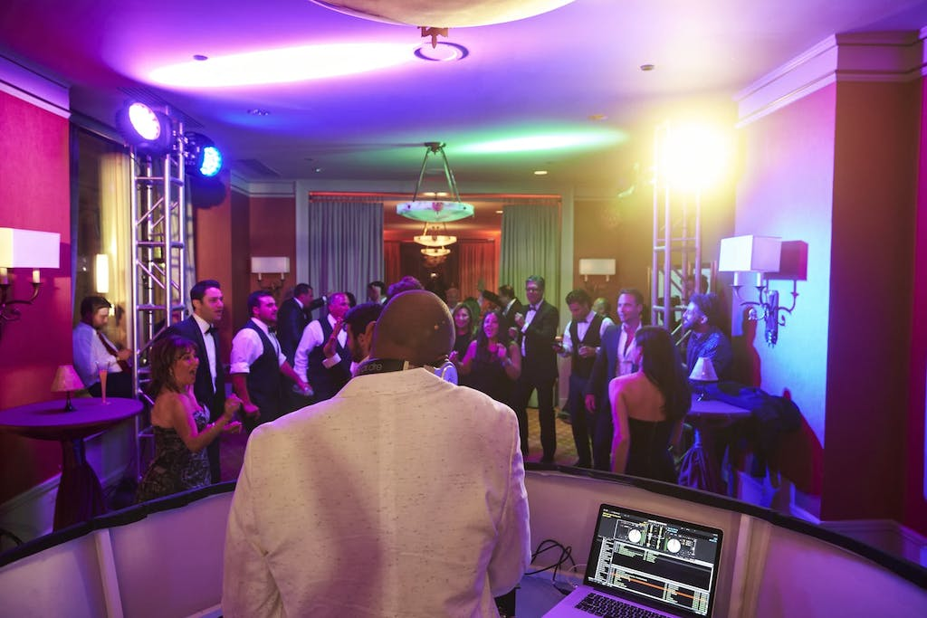 Back of DJ and dancing guests