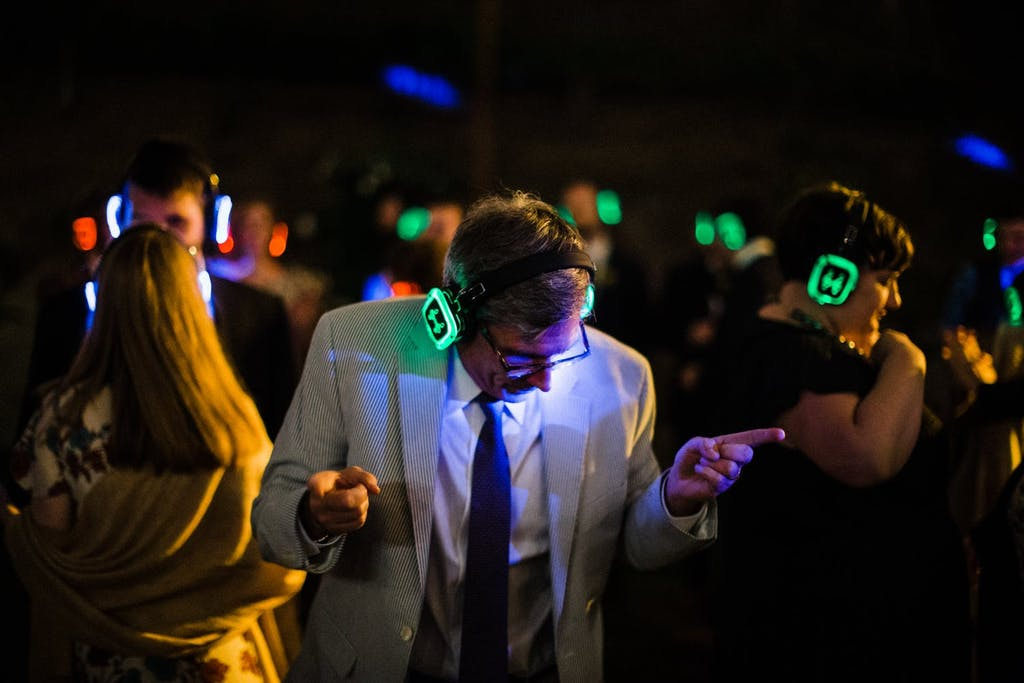 Guest dancing with glow-in-the-dark headphones