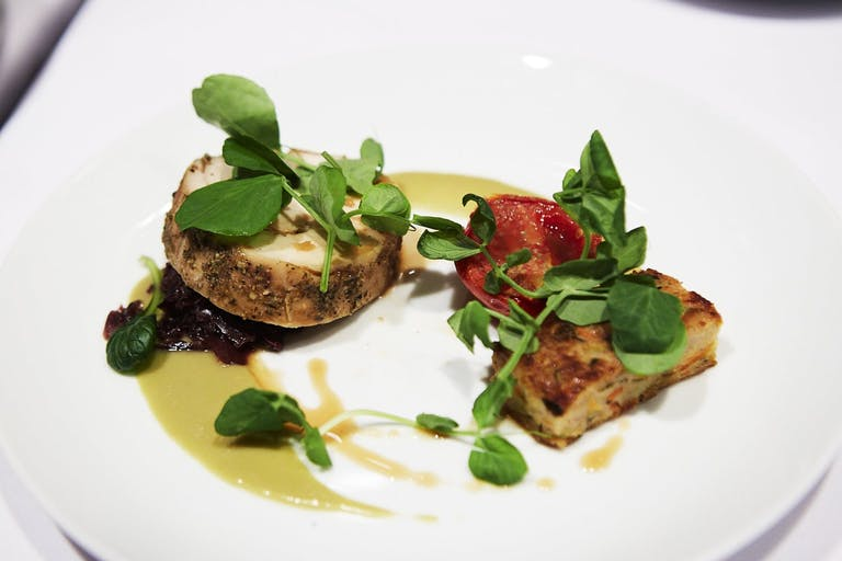 artfully plated fish and herbs