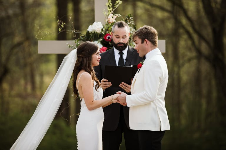 Bride and Groom exchanging vows in forest