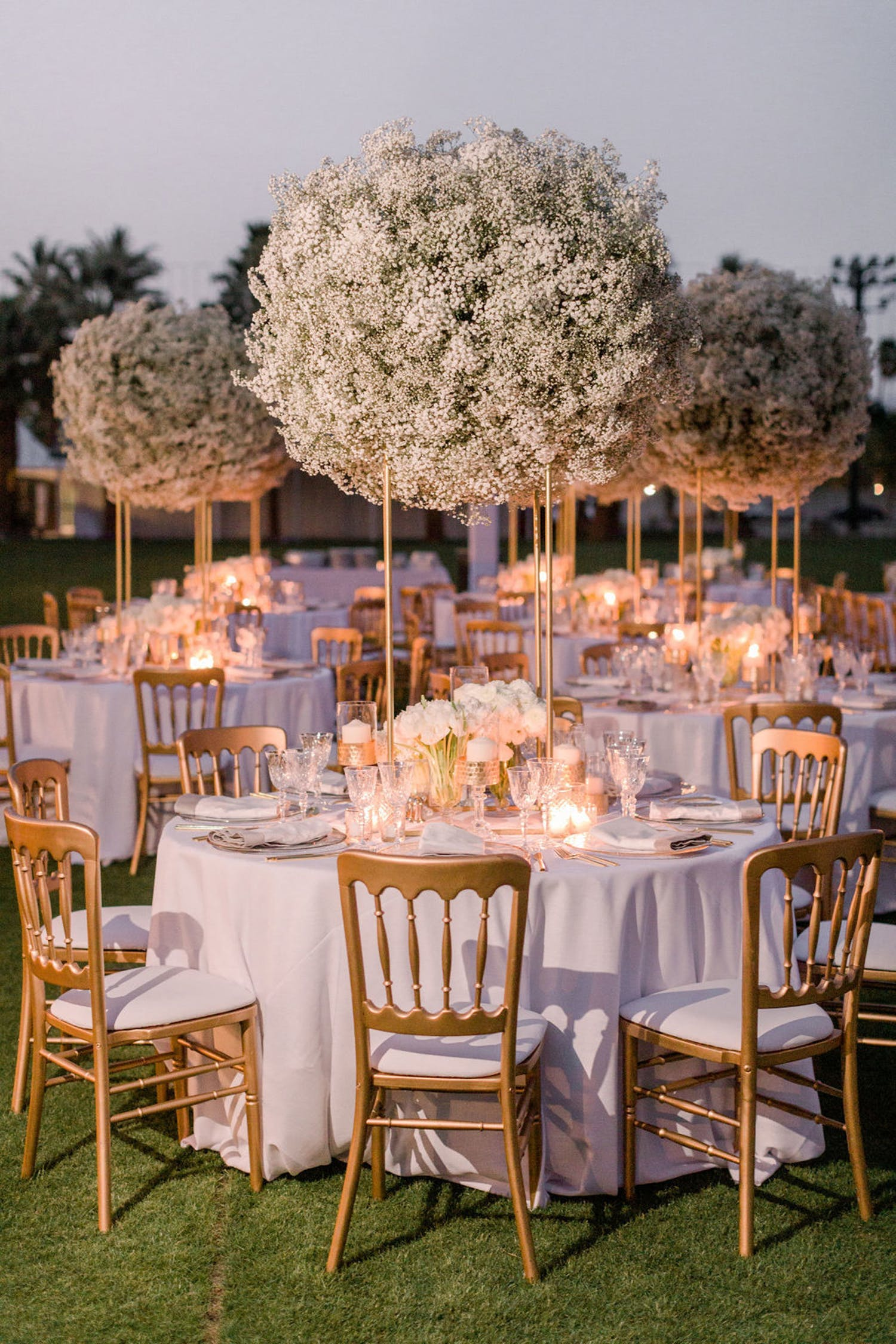 tables with towering baby's breath floral centerpieces