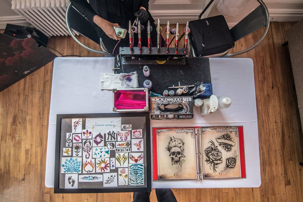 Tattoo and temporary tattoo activity station