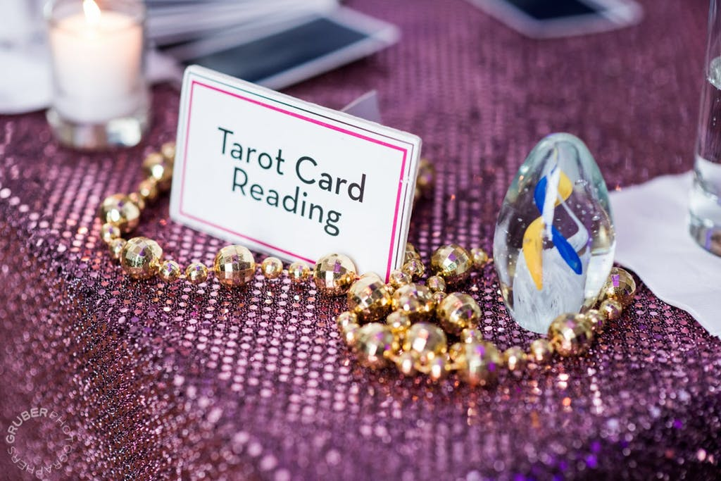 Tarot card reading activity station at a wedding rehearsal dinner   PartySlate
