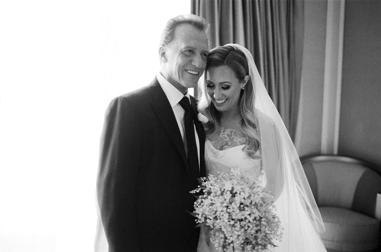 black-and-white portrait of bride with father