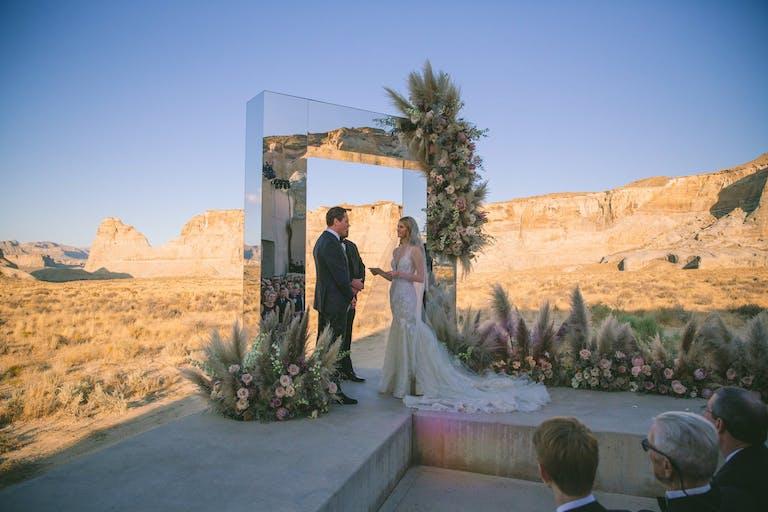 dessert wedding ceremony with mirrored archway