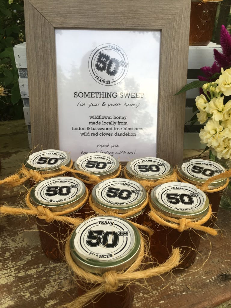Jars of honey party favors for 50th-birthday party