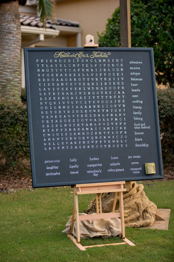 Giant chalkboard word search at an outdoor wedding rehearsal dinner   PartySlate