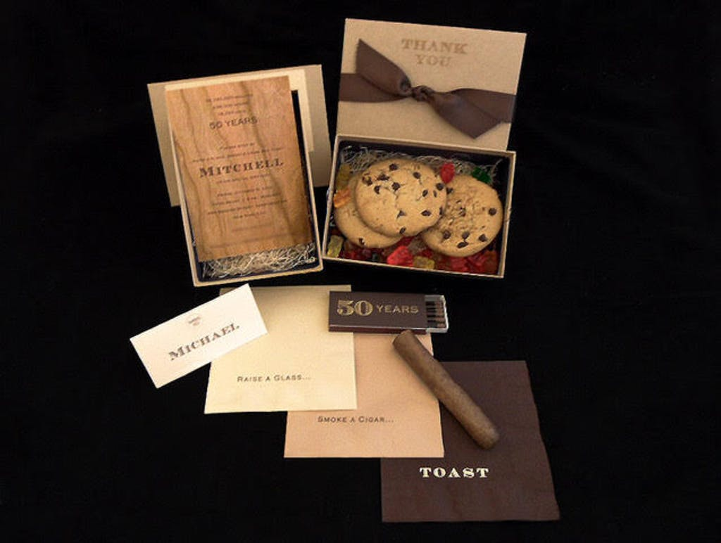 50th-birthday party invitation and party favors of chocolate chip cookies and cigars