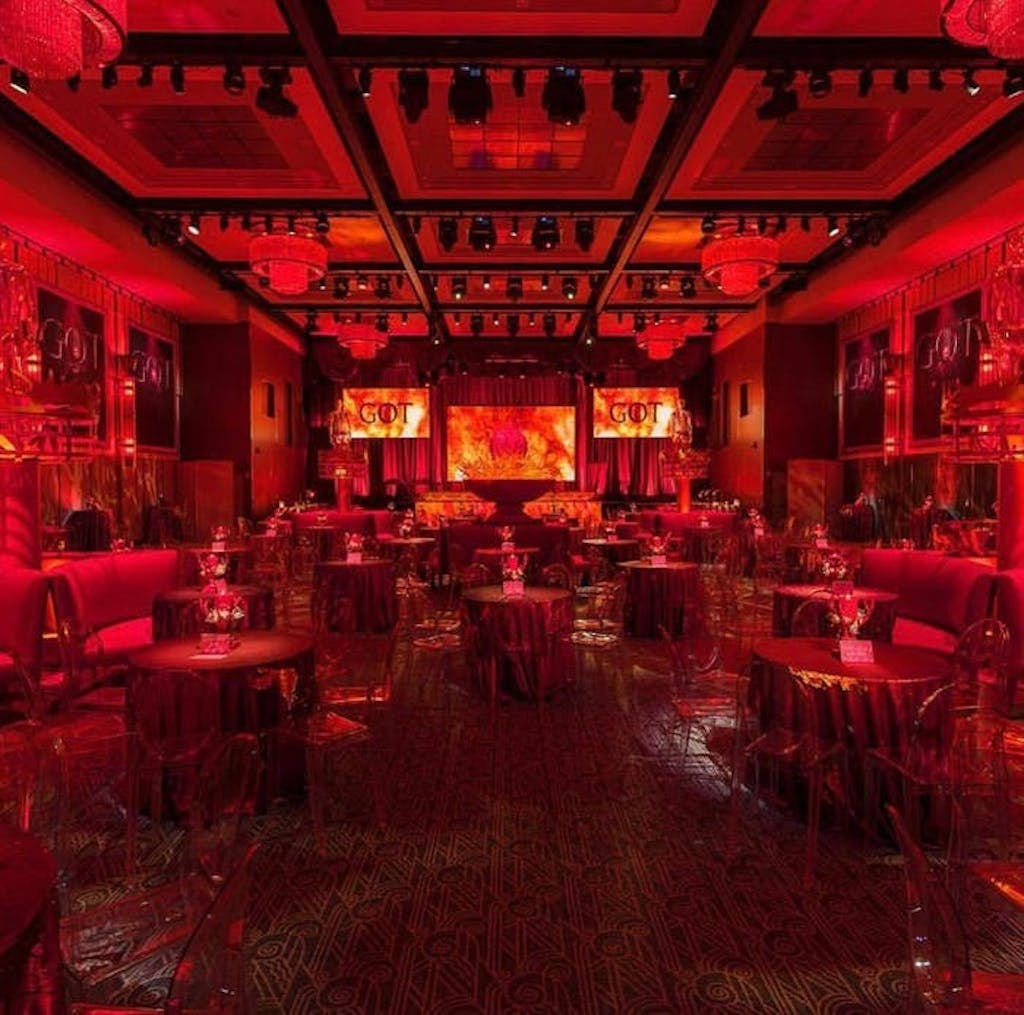 a venue with a great deal of depth with red uplighting taking over the scene
