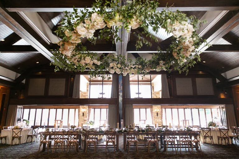 Table in large wood room with circle of flowers on the ceiling.
