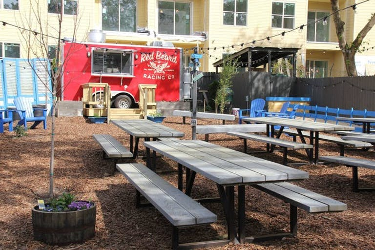 Outdoor picnic benches on woodchips