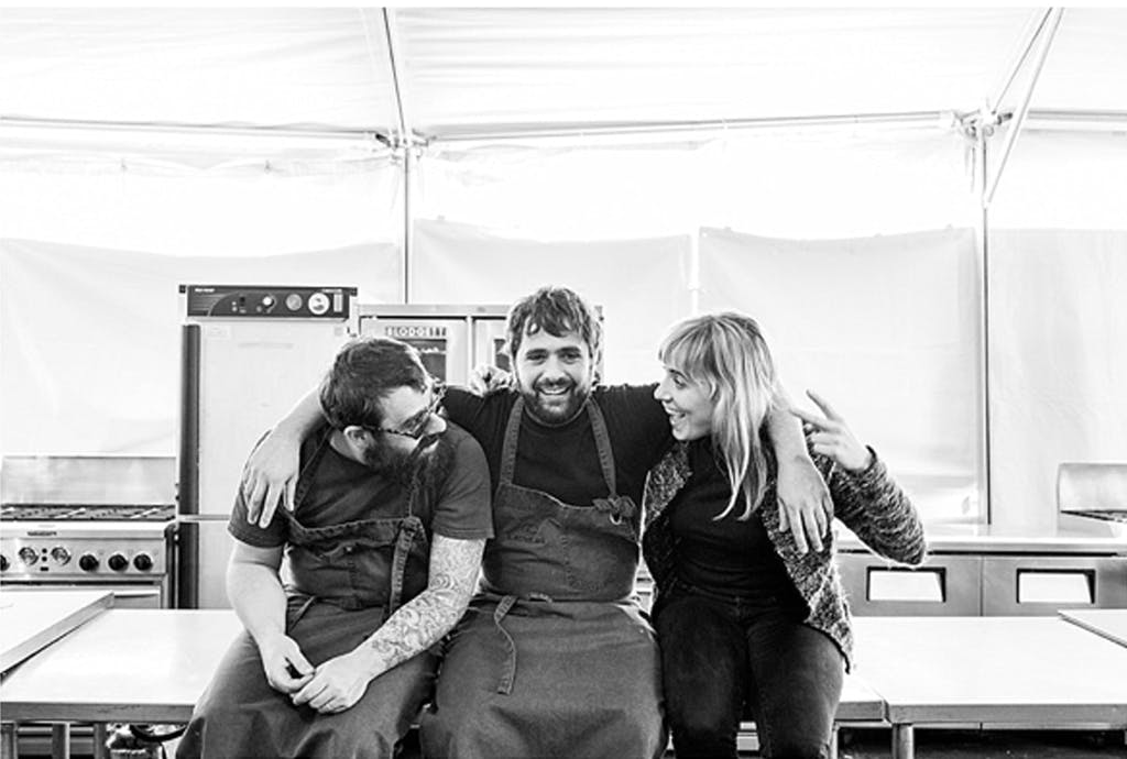 Three caterers take a break from the job to relax and pose for the camera.