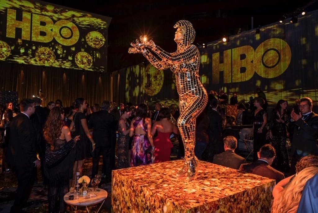 HBO Emmy after-party with performer wearing metallic bodysuit