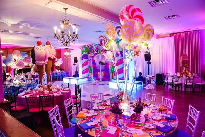 tables with giant lollipop and ice cream installations