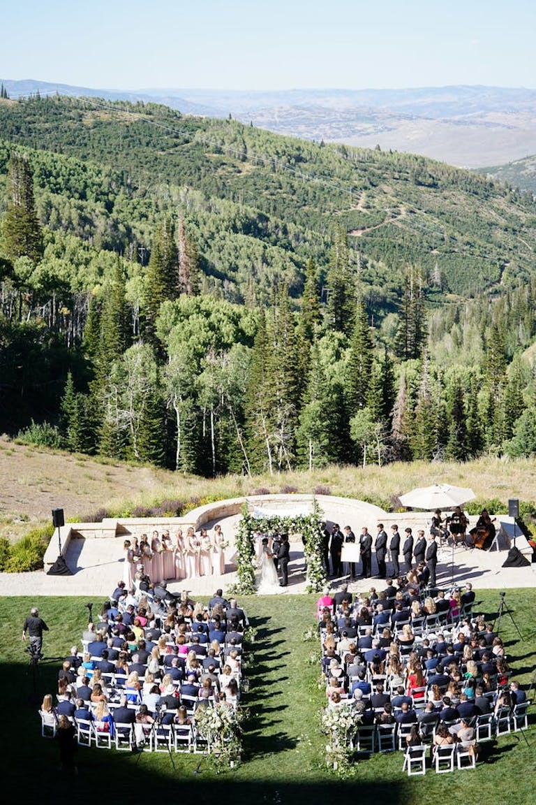 Wedding in mountains with green all around.