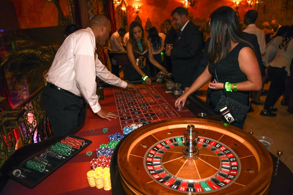 Woman plays roulette at gala.