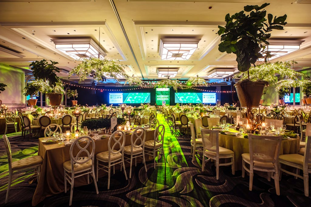 Adler Planetarium Ballroom with  green uplighting and foliage décor.