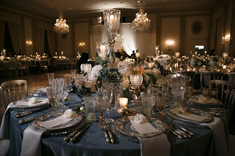 textured glass votives at varying heights with vintage looking florals and warm lighting