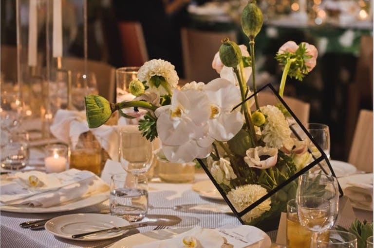 low orchid wedding centerpieces with intricate floral arrangements