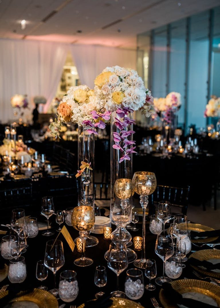 Varying heights of floral arrangements and candles