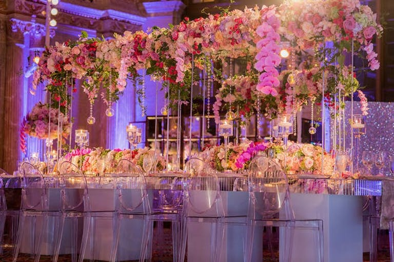 Orchid wedding centerpieces that act as a roof and hang down