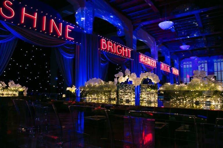 blue archways with red neon signage
