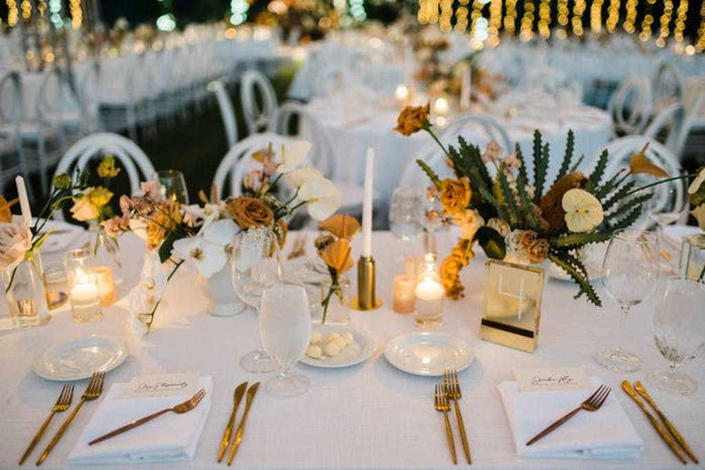 small pillar and votive candles with short succulent centerpieces