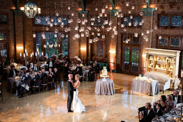 Bride and Groom in the middle of the dance floor with small lights hanging all around.