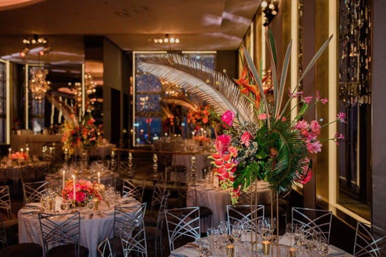 low and high centerpieces with feathers as accent