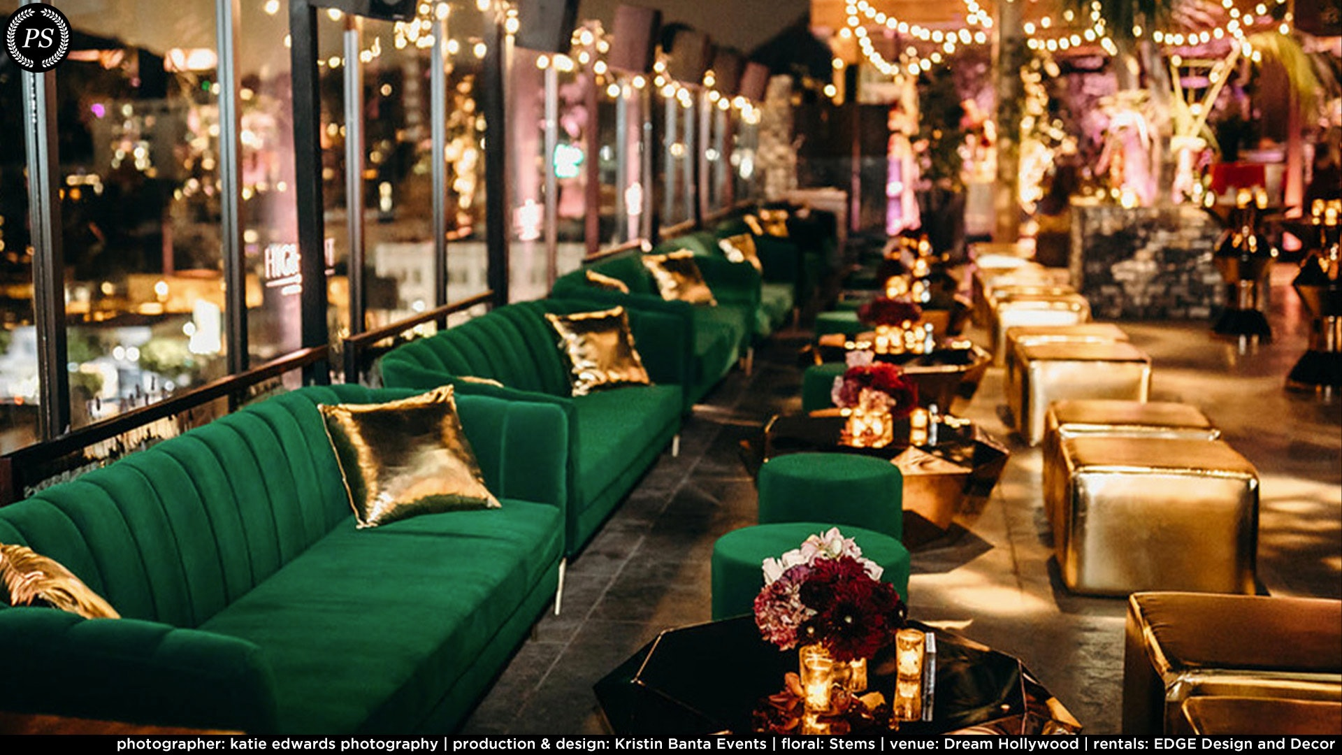 A row of green velvet couches along a mirror reflecting gold accents and tables
