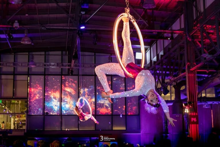 Corporate Event Space-Themed Party With LED-Costumed Drummers and Aerialists | PartySlate