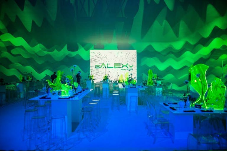 Bar Mitzvah Futuristic Party With Vibrant Green and Blue Uplighting | PartySlate