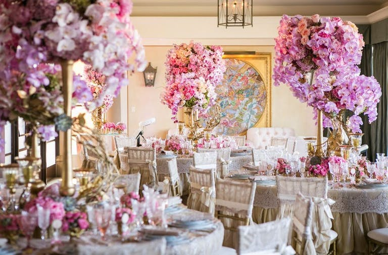 50th Birthday Party With Lavish Pink Floral Centerpieces | PartySlate