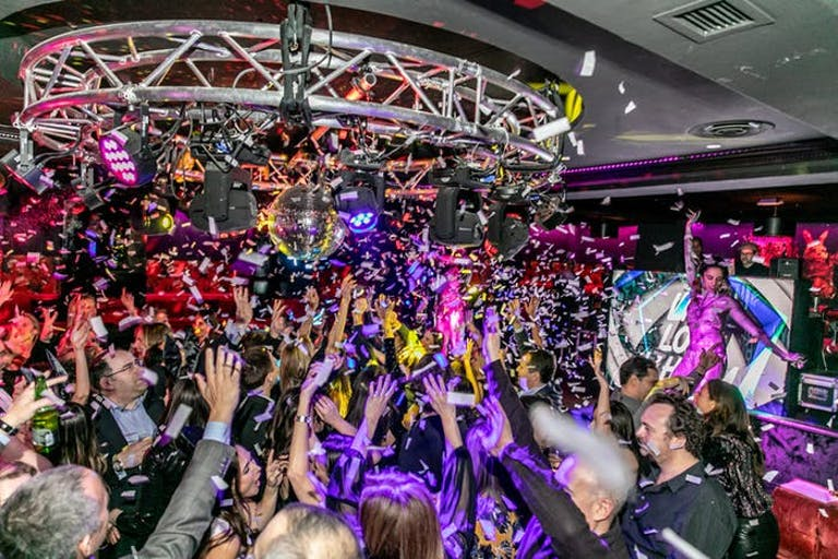 Crowded Dance Floor at 50th Birthday Party at Red Rabbit Club | PartySlate