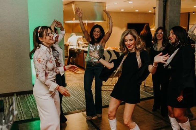 Four Women Dressed in 70s Era Clothing Dance | PartySlate