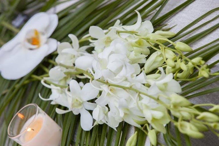 Tropical White and Green Floral Décor and Votive Candle | PartySlate