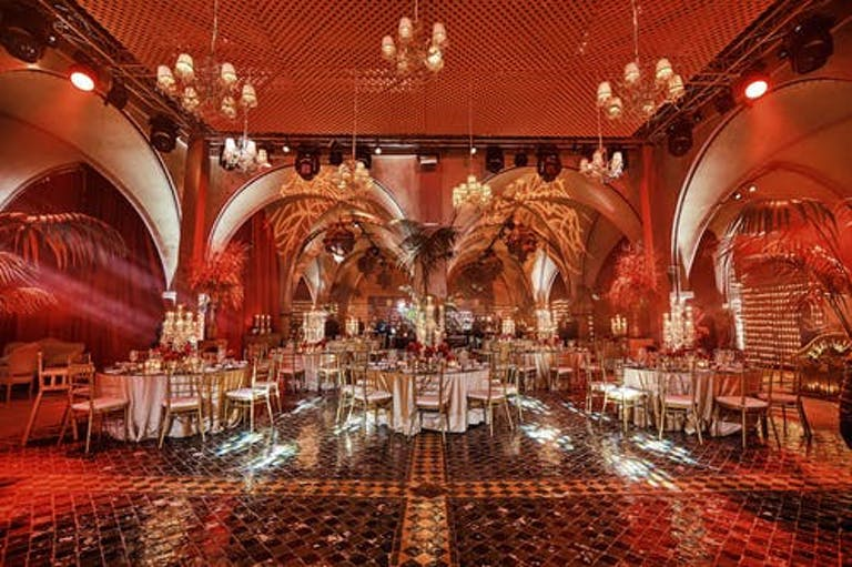 Morocco 50th Birthday Party With Red and Orange Uplighting | PartySlate