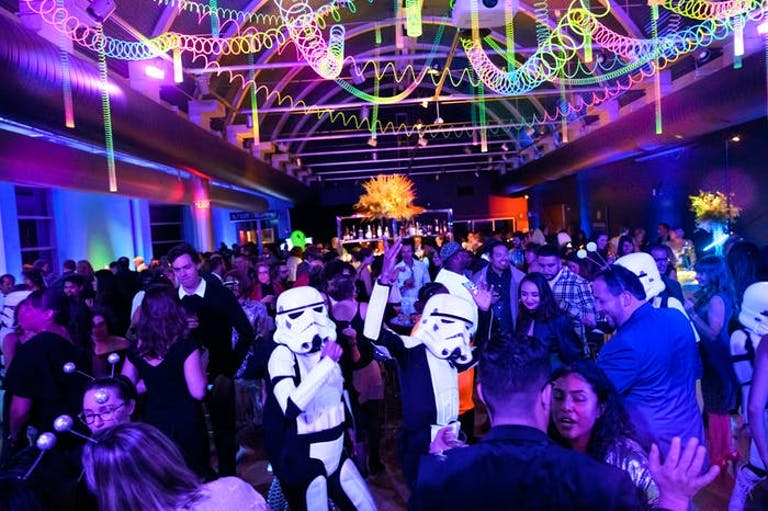 Space-Themed Party With Purple and Blue Uplighting and Storm Trooper Entertainment | PartySlate