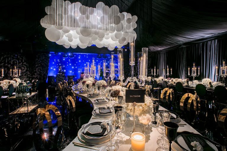 Celestial 50th Birthday Party Theme With Balloon Cloud Installation and Curving Tables | PartySlate