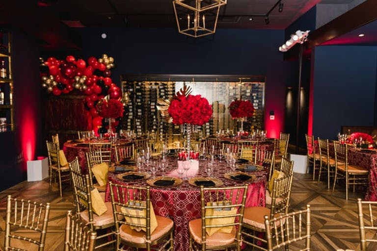 Milestone Birthday Party With Red and Gold Tablescapes and Décor | PartySlate