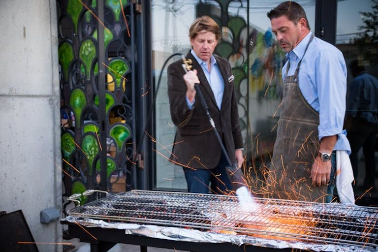 Two Men Cooking at 50th Birthday Party Oyster Roast | PartySlate