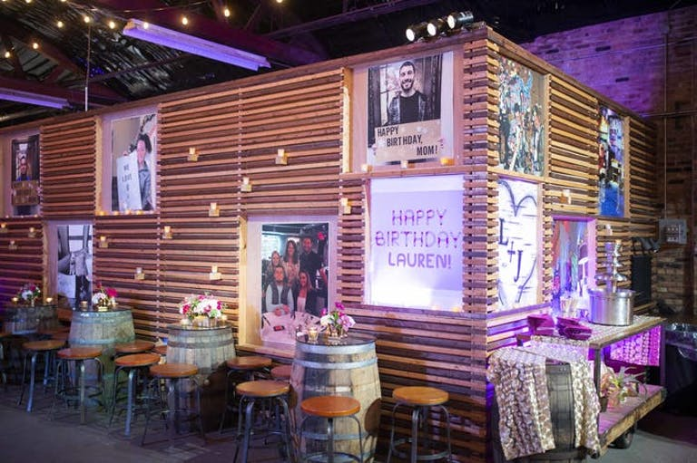 50th Birthday Celebration With Personalized Wall Art and Wine Barrel Tables | PartySlate
