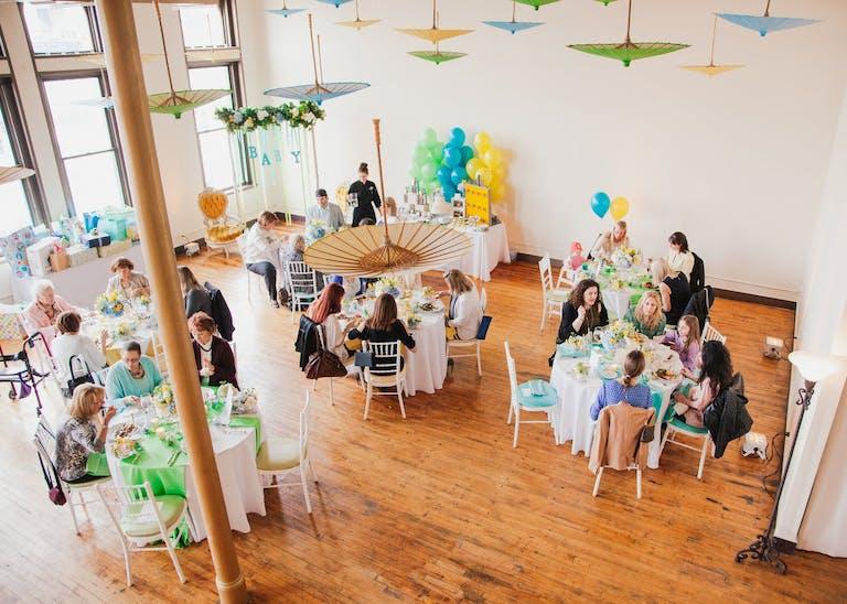 Creativo Loft Baby Shower Venue in Chicago, IL With Umbrella Ceiling Décor
