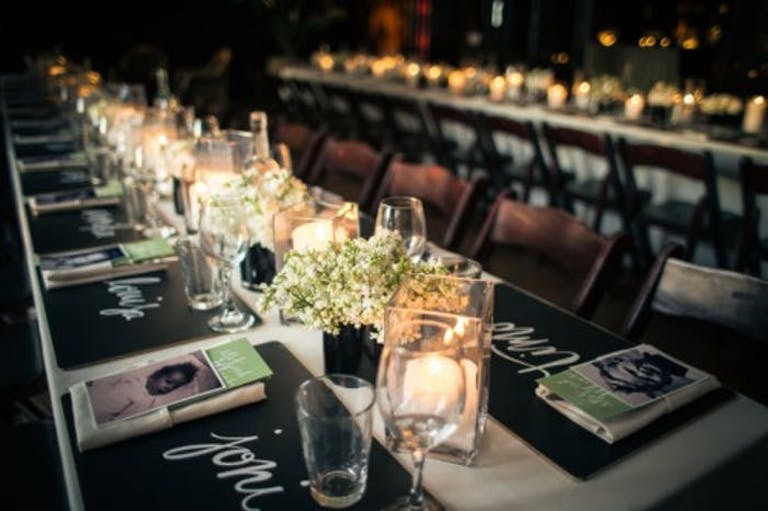 Birthday Party Tablescape With Candlelight and Black Décor Accents | PartySlate