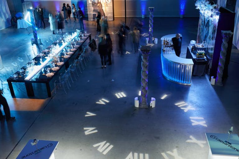 Futuristic Party in Helicopter Hanger With a Clock Lit Up on the Floor | PartySlate