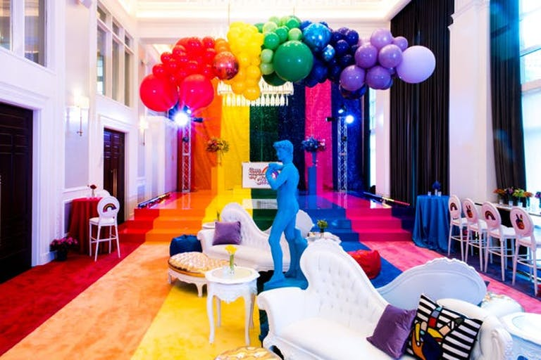 Birthday Party With Rainbow Balloon Installation and Blue Statue | PartySlate