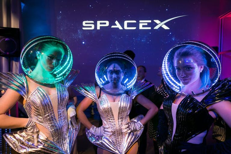 Galaxy-Themed Party With Three Women in Silver Space Costumes and Multicolored Space Helmets | PartySlate