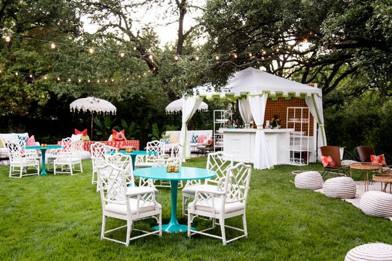 Backyard Outdoor 50th Birthday Party With White Tented Bar and Colorful Cocktail Tables | PartySlate