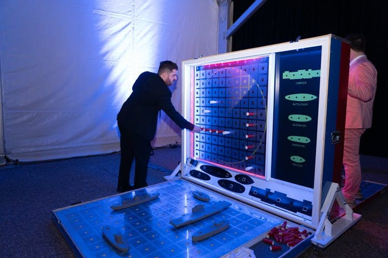 Futuristic Party With Man Playing Larger-Than-Life Battle Ship Game | PartySlate