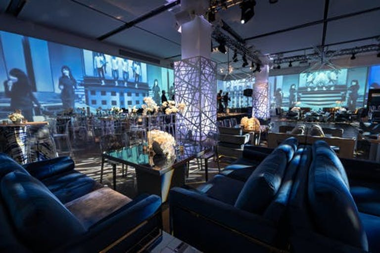 Birthday Party With Blue Furnishing, Blue Uplighting, and Geometric Décor | PartySlate
